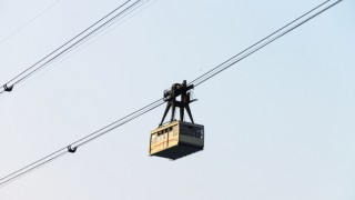 A cableway car running along its cable in the air